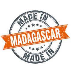Madagascar orange grunge ribbon stamp on white vector