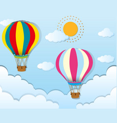Two balloons flying in blue sky vector