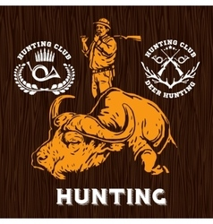 Set of hunting labels on wooden bakground vector
