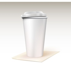 Paper cup for coffee standing on a napkin vector