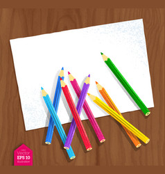 Color pencils lying on paper vector