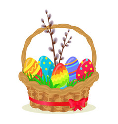 Colorful eggs brench of willow in wicker basket vector