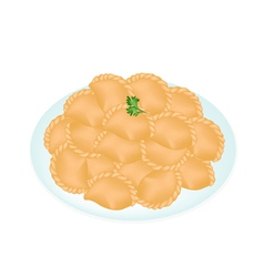 A dish of mini thai curry puffs vector