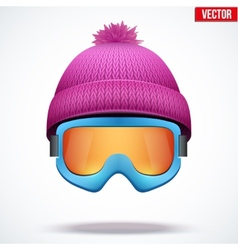 Knitted woolen cap with snow goggles winter vector