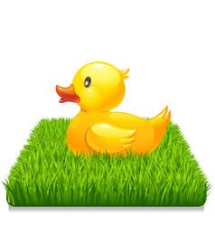 Yellow duck on fresh green grass 10eps vector