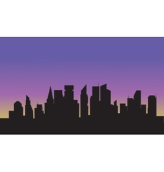 Silhouette of city with purple sky vector