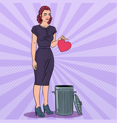 Unhappy woman throws her heart in the trash vector