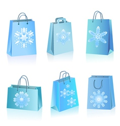 blue paper bags with snowflakes icon vector image vector image