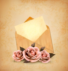 Three roses in front of an old envelope with a vector image