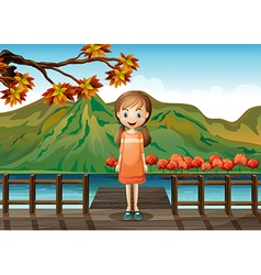 A young girl standing in the middle of the wooden vector