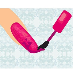 woman applying nail polish on finger vector image