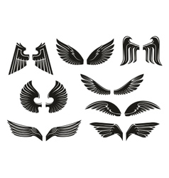 Black tribal heraldic wings set vector