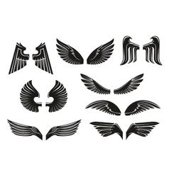 Black tribal heraldic wings set vector image