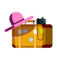 suitcase with pink hat and photo camera isolated vector image vector image