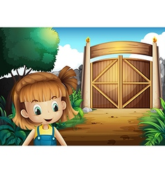A young girl inside the gated yard vector