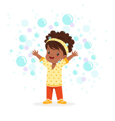 Cute happy little girl playing bubbles vector
