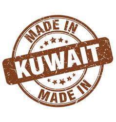 made in kuwait brown grunge round stamp vector image vector image
