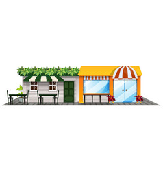 Two shops with outdoor dining area vector