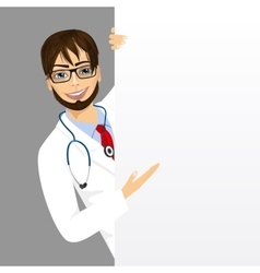 Male doctor with a blank presentation board vector