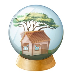 A crystal ball decor with a wooden house inside vector