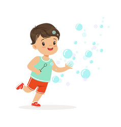 Adorable little boy blowing bubbles vector