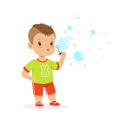 Cute little boy playing with bubble blower vector
