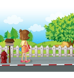 A girl standing near the mailbox at the roadside vector