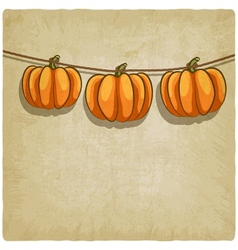 Old background with pumpkins on rope vector
