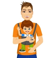 Father holding little boy with baby carrier vector