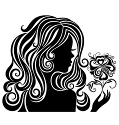 Silhouette of a girl with a flower vector