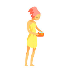 Woman with hair wrapped in towel holding bucet of vector