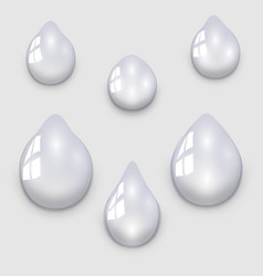 set of transparent water droplets on a light gray vector image