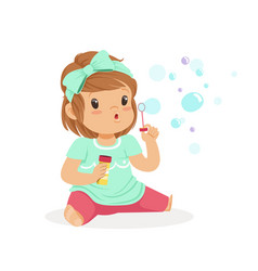 Adorable little girl sitting blowing bubbles vector