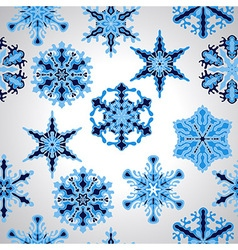 Seamless pttern with blue snowflakes vector
