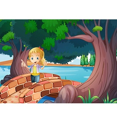 A girl at the bridge near the giant trees vector image vector image