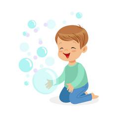 Happy boy kneeling playing bubbles vector