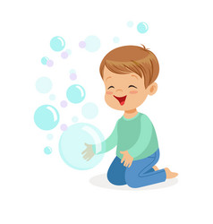 Happy boy kneeling playing bubbles vector
