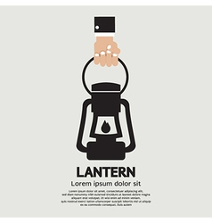 Hand holding a lantern vector