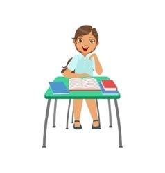 Schoolgirl Sitting Behind The Desk In School Class vector image