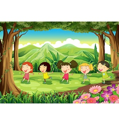 Five girls playing in the middle of the forest vector image vector image