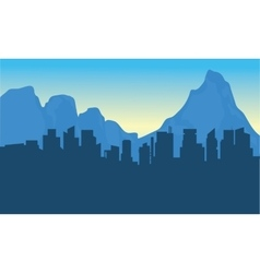 Silhouettte of city and background mountain vector image vector image