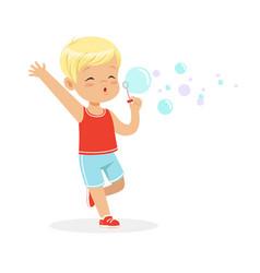 Cute little blonde boy blowing bubbles vector