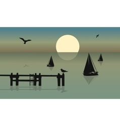 Silhouette of ship and bird vector