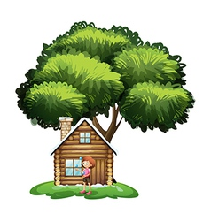 A small house under the tree with a girl outside vector image