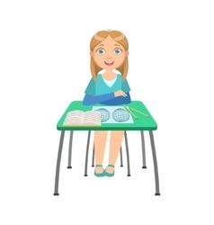 Schoolgirl sitting behind the desk in school vector