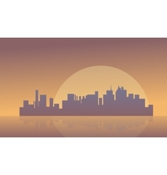 Silhouette of buildings and big moon vector