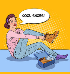Woman trying on new boots in a store pop art vector