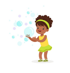 Cute smiling little girl playing bubbles vector