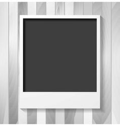 Grey blank polaroid photo frame on wood vector