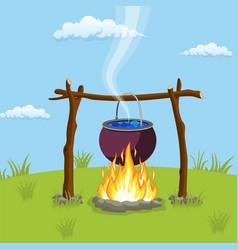 black camping pot over a bonfire vector image